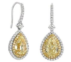4.00 Carat Fancy #YellowPearCutDiamond Earrings Pair of Fancy Yellow Pear Shape Diamond Earrings (1.94ct VS1/ 2.06ct IF). Earrings are set with white and yellow diamonds in 18K white and yellow gold.
