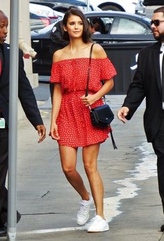 Nina dobrev wearing a red polka dot dress