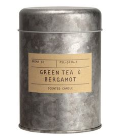 Silver/green tea-bergamot. Scented candle in metal holder with paper label. Diameter 3 in., height 4 1/4 in. Burn time 30 hours.