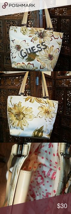 Guess bag Great condition bag. Has a few pen stains in the the bag as shown on photos and on the bottom of the bag. (Pre-own) Guess Bags Mini Bags