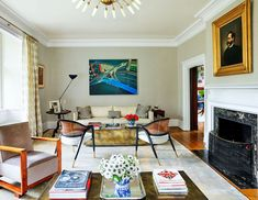 "The theme of Designer Janine Carendi MacMurray's design was ""coming home."" The clients wanted the house to feel sophisticated, light, and contemporary while honoring the family's history. #pittsburgh #pittsburghhome #home #interiordesign #renovation #architecture #remodel #modernhome #tudorhome #design #decor #elledecor Mahogany Table, Elle Decor, English Furniture, House Interior, Beautiful Interior Design, Living Room Inspiration, Interior, Window Seat Cushions, Room Inspiration"