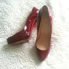 Christian Louboutin Rolando pump Burgundy red patent leather. 5 Inch heel. I wore these maybe 3 times. Bought at Neimans in Boston several years ago. Comes with duster bags. Sorry I did not keep the box. These did run small so I went up a full size. So they will fit a true size 9.  Price reduction 6-18-16 Christian Louboutin Shoes Heels