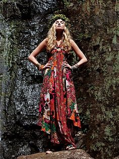 channel your inner bohemian by pairing a patterned maxi dress with loose waves