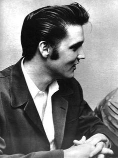 Elvis Presley, sweet baby jebus look at those cheekbones!  that hair!  SWOON