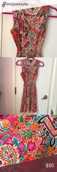 AMAZING FLORAL Ralph Lauren Label says PXS. FITS LIKE A SMALL. Vibrant collage of color. Ruffled around neck. Tapered slightly around waist for a great fit. Matching belt. Dry cleaned only a couple of time so the colors are super vibrant, like new. In excellent condition🌻 Lauren Ralph Lauren Dresses Midi