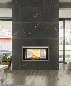 Photo features Marazzi products Classentino Marble in Centurio Black (Unpolished) on the fireplace and Chateau Reserve in Shadow Mountain on the floor. Tiled Fireplace Wall, Fireplace Redo, Black Fireplace, Fireplace Remodel, Marble Fireplaces, Modern Fireplace, Fireplace Design, Romantic Home Decor, French Home Decor