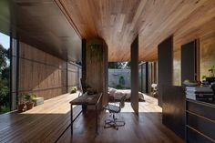 View across the workspace and bedroom into the courtyard. Sawmill House by Archier.