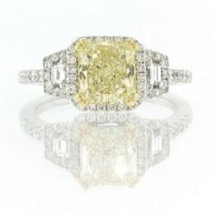 Yellow diamond engagement ring. Whoa. i sooooo want this lol i already have 2 but yellow is my favorite color