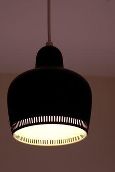 An Alvar Aalto Golden Bell ceiling light, originally designed in 1937 for the Savoy Hotel, Helsinki.