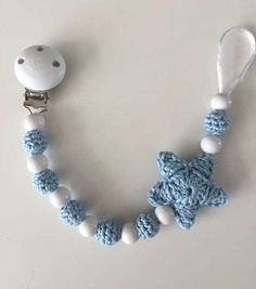 Crochet pacifiers: original ideas photos - Pacifier with balls and star . - Crochet pacifiers: original ideas photos – Pacifier with balls and white and blue crochet star - Crochet Bib, Crochet Baby Toys, Crochet Stars, Crochet Baby Booties, Crochet Gifts, Crochet For Kids, Baby Knitting, Baby Diy Projects, Crochet Projects
