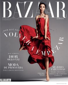Mariacarla Boscono flaunts her posing skills in a red Lanvin dress on the cover of Harper's Bazaar Spain.