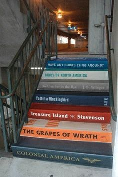 stairs painted as books ...I'd select some of my favorite books: Huck Finn, Walking On Water (Madeleine L'Engle!), Orbiting the Giant Hairball, The Creative Habit (Twyla Tharp), The Trickster's Hat (Nick Bantock, 2014) . . .