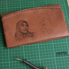Artwork drawing on genuine leather wallet handcrafted, handsticking, hotpen(solder) Made in Bandung Indonesia (west java) whatsapp +6281322365446