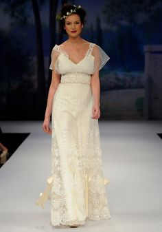 CHATEAU MARMONT    Spring 2012  Ivory embroidery over cotton with silk bows, beaded lace bodice with guipure edged tulle overlay