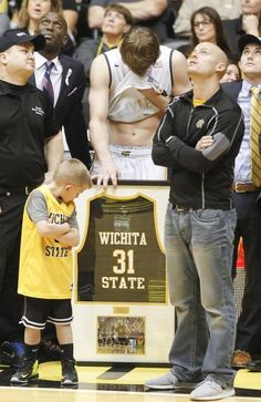 Ron Baker wipes away tears as he and four other seniors are honored after their game against Illinois State on Saturday.