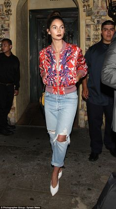 Girls' night! Miranda's supermodel pal Lily Aldridge, looked as fashion-forward as ever in a silk bomber jacket that was adorned with a vibrant baroque print