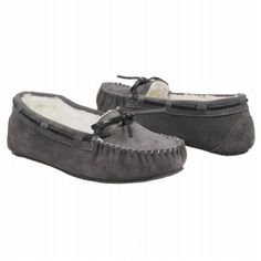 Rest comfortably indoors or out in the leather moccasin style Minnetonka Britt Trapper slipper. Charming features include a decorative leather ribbon that ties in a bow, rustic stitching at toe and heel seems and luxurious faux fur lining with a cushioned insole. Leather upper with round moc toeDecorative leather ribbon weaves, padded collar, cushioned insoleTraction grippy indoor/outdoor outsole
