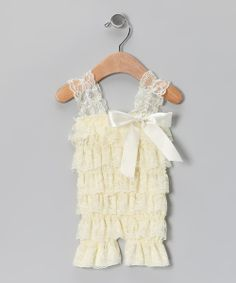 Resplendent with ruffles, this romper glams it up with girly style. From the comfy elastic shoulder straps and the stretchy bodice to the brilliant bow, this lovely lacy wonder is a showstopping number.90% polyester / 10% spandexHand wash; hang dryImported