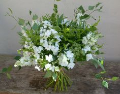 Handtied bouquet made with White Hydrangea, White Larkspur, White phlox and Silver Birch, grown and arranged by Sussex Cutting Garden.