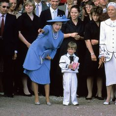 Queen Elizabeth points out some details to little Prince William after the Duke and Duchess of York's wedding ceremony in 1986.