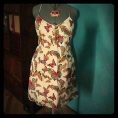 Colorful Butterfly Tank Dress Worn once. Straps are adjustable. Top back bodice has stretch to it as shown in photos. Pockets. Extremely comfortable to wear. Has inside lining on the skirt. All my items come from a teacup chihuahua's smoke and odor free home. If you have any questions please do not hesitate to ask. I am online daily. Old Navy Dresses