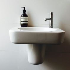 Caroma Marc Newson Wall Basin and a Sussex Scala Mini Basin Mixer installed at @bellevillemelbourne. @sussextaps @caromaaustralia by e.hplumbing Bathroom designs.