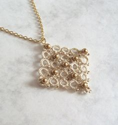 Tudor Cross Beaded Ecru Lace Pendant in Tatting by TataniaRosa, $28.00   (to go with my earrings)