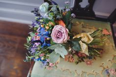 Image by www.lmweddings.co.uk Blues & lilacs with pops of melon brightness.