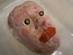 Here's the one I made for our Halloween Pot Luck at work. It turned out great! I did a Bacon Jalapeno Cheddar Cheese Ball recipe under the flesh (thin shaved ham).