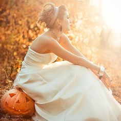 A Halloween Wedding in Autumn. I like the idea of sitting on a pumpkin, just not a halloween pumpkin