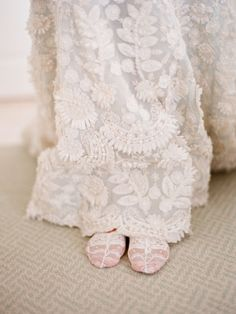 A vintage lace dress with delicate slippers is perfectly appropriate for a chapel ceremony or one outside underneath a flowering tree. #Weddings