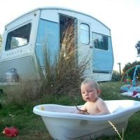 Angus Winneke (1), of Dunedin, takes a bath during a holiday in his family's 1974 Sprite caravan. Photo by Andy Winneke.