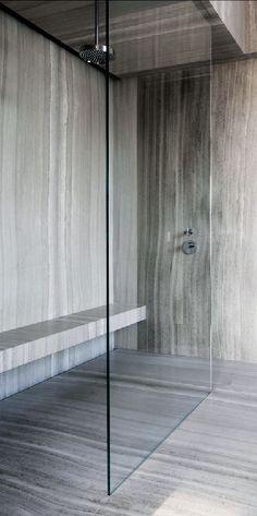 Silver veined travertine feature shower