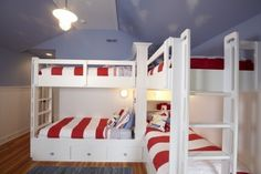 Bunk beds with striped duvets. Love the color combo and wood floors.