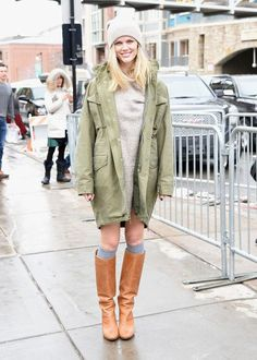 Brooklyn Decker looked cute-but-casual at Sundance in tall socks and boots, a cozy gray sweater dress, and an army green parka. Click for more!