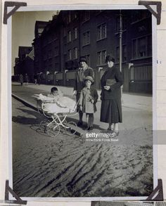 Margot, her mother Edith and her grandmother Alice Frank with Margot's cousin Stephan Elias in front of their house in Frankfurt, Germany.