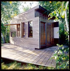 Small house The exterior is clad in an elegant mish-mash of cedar, plywood, glass, and fiberglass panels.-enns-house-exterior