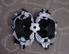A personal favorite from my Etsy shop https://www.etsy.com/listing/231627144/soccer-hairbow-black-white-soccer-hair
