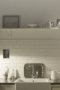 Cream cabinets, white subway tiles, grey (cement?) counters for our kitchen.