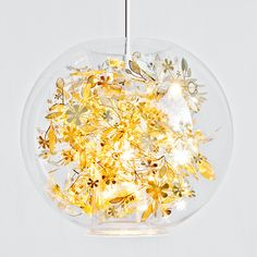 Garland Globe Brass Rubber by Tord Boontje // The fishbowl-like glass dome houses a removable piece of metal garland that is etched with delicate flowers.