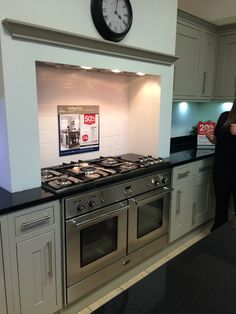 Wickes: love the 'mock chimney breast' style around this Rangemaster cooker. Like the discreet lights and extractor hood too.