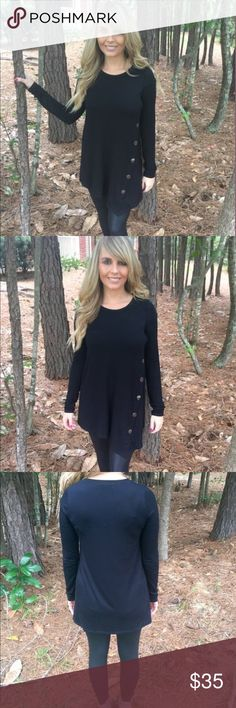 Black side button top This black top features a scoop neckline, asymmetrical buttons and long sleeves. This is the perfect everyday top. Pair this top with your favorite scarf and leggings. Fits true to size.  -95% rayon 5% spandex   -wearing size small Tops Blouses