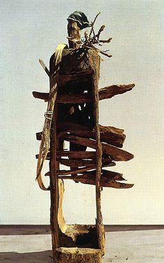 El Anatsui (Ghana), Tapper, 1996. Wood, height 180cm.