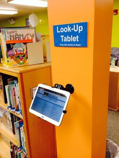 Use a tablet instead of computers for a library catalog station. <-- my library has one. Teen Library Space, School Library Design, Middle School Libraries, Elementary School Library, Children's Library, Dream Library, Future Library, Library Posters, Library Signage