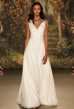 Brides: Jenny Packham. Silk chiffon sheath gown with V-neck and metallic beading details.