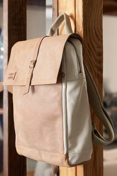 Canvas + Leather = The TOMS Trekker Backpack for your next adventure featuring an interior padded 13 inch tech pocket.