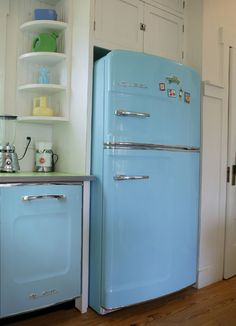 Baby blue refrigerator and dishwasher; rounded corner shelves