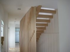 Unique all wood design with single stringer and baluster wall. Via Skyhook San Diego