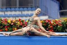 Synchronized swimming fasion - Americans Andrea Nott & Christina Jones get set to jump in.