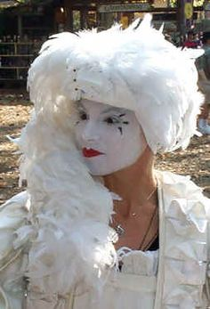 Mimi the mime at the Maryland Renaissance Festival models a feather hat suitable for the bride Maryland Renaissance Festival, Angel Costumes, Festival Image, Feather Hat, Swan, Models, Bride, Hats, Clothes